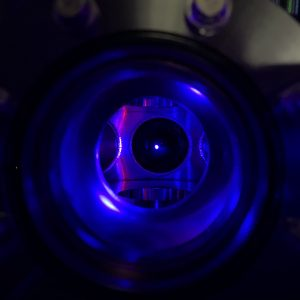 a blue glowing dot in the center of a chamber