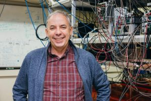 Mark Saffman standing in his lab